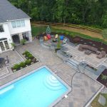 aerial view of inground pool & paver patio