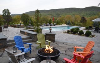 fire pit with adirondack chairs & inground pool