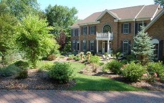 brick house with landscaping