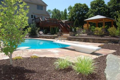 inground pool with diving board