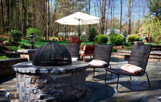 fire pit with wicker furniture around it