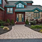 wood & stone house with brick paver patio